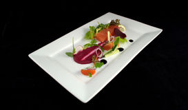 Fresh Salmon with Salad. On the white plate royalty free stock photos