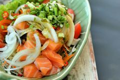 Fresh salmon salad with spices - Japanese food. Stock Photo