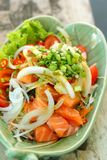 Fresh salmon salad with spices - Japanese food. Royalty Free Stock Images