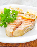 Fresh salmon served with rice parsley lemon Royalty Free Stock Images