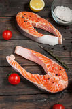 Fresh salmon slice with spice on old wood background Royalty Free Stock Images