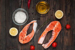 Fresh salmon slice with spice on old wood background Stock Photography