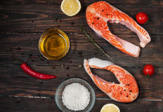 Fresh salmon slice with spice on old wood background Stock Photo