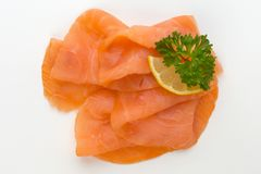 Fresh salmon slice and spice on the white background. Fresh salmon slice and spice on the white background Royalty Free Stock Photos