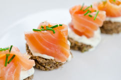 Fresh salmon snack. Canapes with smoked salmon and cream cheese royalty free stock photography