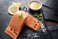 Fresh salmon with spices, cooking concept Stock Image