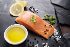 Fresh salmon with spices, cooking concept Royalty Free Stock Photography