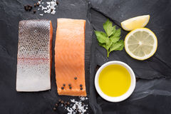 Fresh salmon with spices, cooking concept Stock Images
