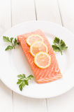 Fresh salmon with spices and lemon Stock Photography