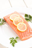 Fresh salmon with spices and lemon Royalty Free Stock Photos