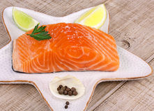 Fresh salmon. With spices over wooden background Stock Images