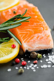 Fresh salmon. With spices and salt Stock Photos