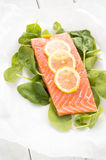 Fresh salmon with spinach and lemon Royalty Free Stock Photo