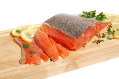 Fresh salmon steak. Raw salmon fillet on a wooden cutting board Stock Photos