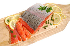 Fresh salmon steak. Raw salmon fillet on a wooden cutting board Stock Image