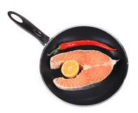 Fresh salmon steak in frying pan. Royalty Free Stock Photo