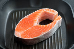 Fresh salmon steak on the grill pan Stock Photos