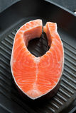 Fresh salmon steak on the grill pan, vertical Stock Images