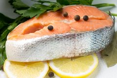Fresh Salmon Steak with herbs  in pot Stock Image