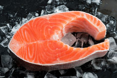 Fresh salmon steak on ice, top view. Close-up Stock Photography