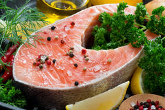 Fresh salmon steak and ingredients for cooking, close-up Royalty Free Stock Images