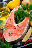 Fresh salmon steak and ingredients for cooking, close-up Stock Image