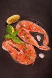 Fresh salmon steak and ingredients for cooking on a grill pan Royalty Free Stock Photography