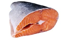 Fresh salmon steak isolated on the white background. Salmon Red Fish Steak. Large Pile of trout steak. Big organic steaks of salmo. N lined up. Big pieces raw Stock Images