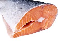 Fresh salmon steak isolated on the white background. Salmon Red Fish Steak. Large Pile of trout steak. Big organic steaks of salmo. N lined up. Big pieces raw Royalty Free Stock Images