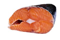 Fresh salmon steak isolated on the white background. Salmon Red Fish Steak. Large Pile of salmon steak. Big organic steaks of salm. On lined up. Big pieces raw Royalty Free Stock Images