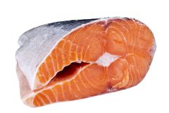 Fresh salmon steak isolated on the white background. Salmon Red Fish Steak. Large Pile of salmon steak. Big organic steaks of salm. On lined up. Big pieces raw Stock Image