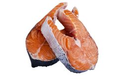 Fresh salmon steak isolated on the white background. Salmon Red Fish Steak. Large Pile of trout steak. Big organic steaks of salmo. N lined up. Big pieces raw Royalty Free Stock Photos