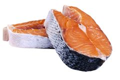 Fresh salmon steak isolated on the white background. Salmon Red Fish Steak. Large Pile of trout steak. Big organic steaks of salmo. N lined up. Big pieces raw Stock Photo