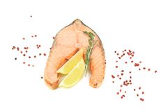 Fresh salmon steak with lemon and pepper. Stock Image