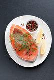 Fresh salmon steak, lemon and pepper, vertical, top view Royalty Free Stock Photography