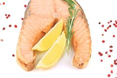 Fresh salmon steak with lemon and pepper. Royalty Free Stock Image