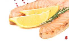 Fresh salmon steak with lemon and pepper. Stock Images