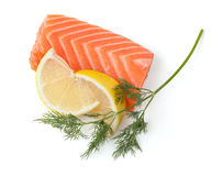 Fresh salmon steak with lemon slices and dill Stock Images