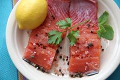 Fresh salmon steak with lettuce leaves royalty free stock photo
