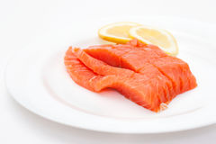 Fresh salmon steak over white background Royalty Free Stock Photos
