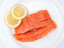 Fresh salmon steak over white background Stock Photos