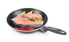 Fresh salmon steak on pan. Royalty Free Stock Photography