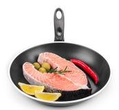 Fresh salmon steak on pan. Royalty Free Stock Image
