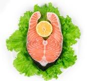 Fresh salmon steak with pepper and lemon. Stock Image