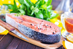 Fresh salmon. Steak with pepper and salt Stock Photography