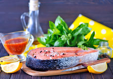 Fresh salmon. Steak with pepper and salt Stock Photo