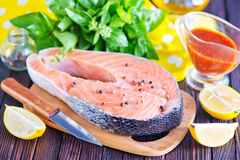 Fresh salmon. Steak with pepper and salt Stock Photos