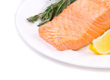 Fresh salmon steak on a plate Royalty Free Stock Photo
