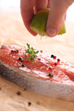 Fresh salmon steak with rosemary Royalty Free Stock Photography