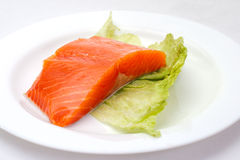 Fresh salmon steak on white plate Stock Photos